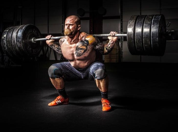 man squatting