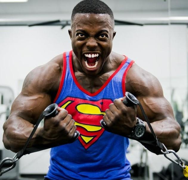 Muscular Man On Weight Machine