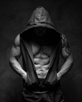 Muscular man in hoody