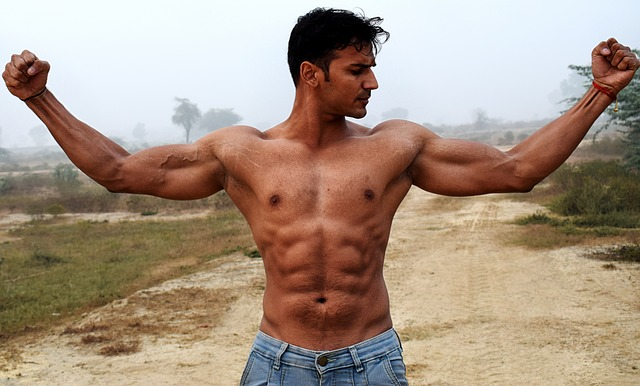 Muscular man showing armpits