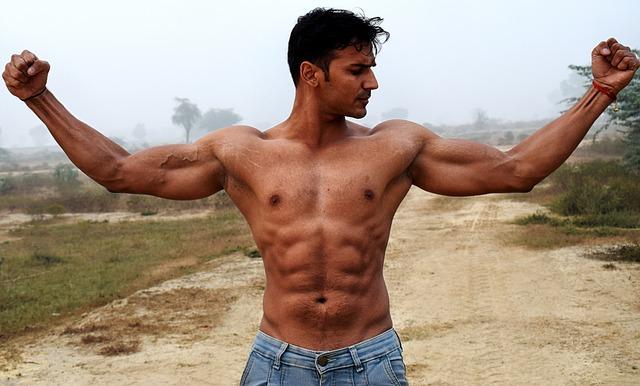 Muscular man showing armpits
