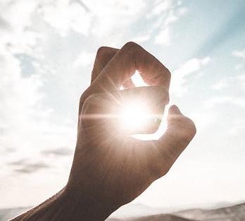 hand-around-sun